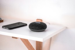 An image of a phone and a speaker